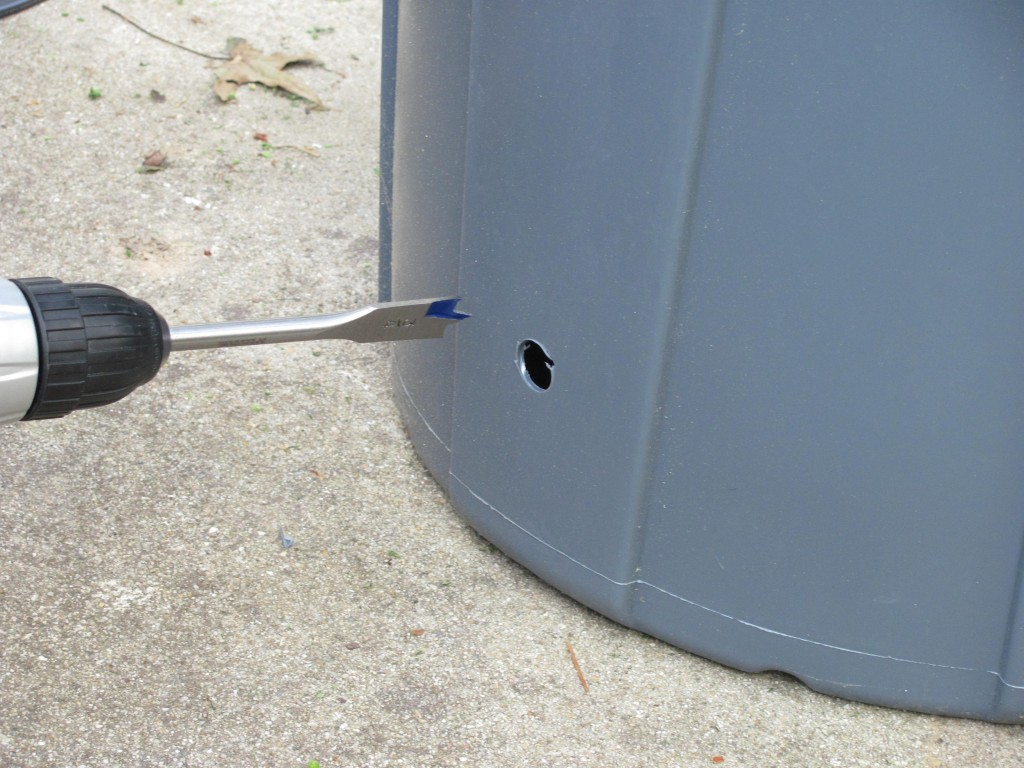 Drilling a hole in a trash can
