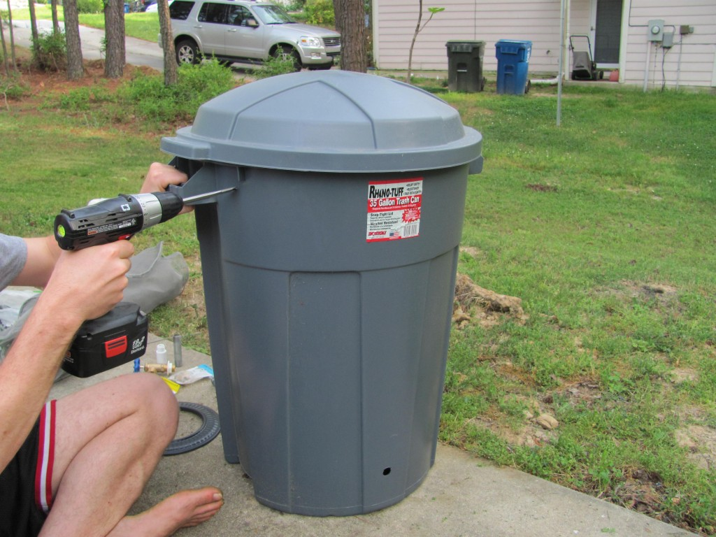 Drilling hole in rain barrel